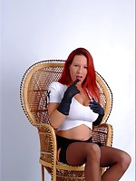 Horny Redhead Fay cups her big tits and ass with her long buttery pair of leather gloves