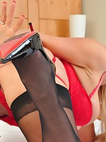 A classic set of sexy Lucy Zara in a red basque and black stockings, shot seductively in a hotel room