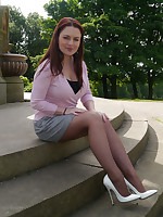 Gorgeous busty Sara visits a monument and invites you to watch her in her lovely white stilettos