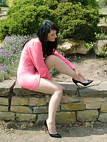 Cute brunette Elise works on your fetish wearing a tight pink summer dress and shiny black stilettos