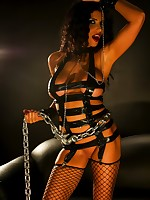 Sexy Romi in chains and leather