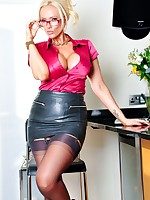 Secretary Lucy Zara is working in her fully fashioned stockings