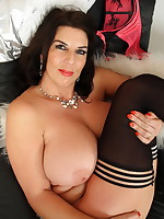 Big breasted British housewife playing with her pussy