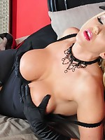 Stunning blonde Lucy Zara is very burlesque in her sexy black lingerie, stockings and hat