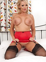 Lucy Zara busting out of see thru' frilly blouse, red corset and black ff nylons!