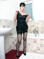 Tanya in the bath wearing black slip and RHT nylons!