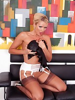 Blonde Lucy Zara waiting for an interview dressed to impress in ff stockings and stilettos.