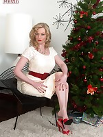 Holly unwraps her girdled and nyloned self!