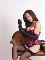 Sexy brunette Tina is dressed in her long black leather gloves posing as femdom with a huge cane
