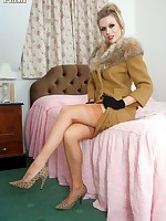 Haughty Michelle in fur trimmed suit, open bottom girdle and jazzy nylons!
